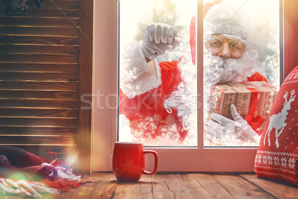 Santa Claus is knocking at window Stock photo © choreograph