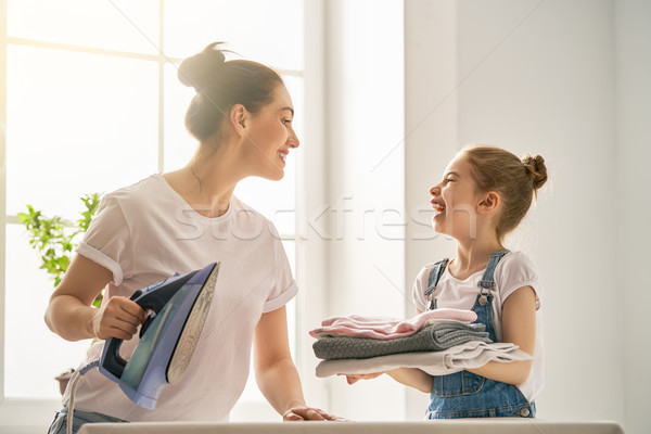 mother and daughter ironing at home Stock photo © choreograph
