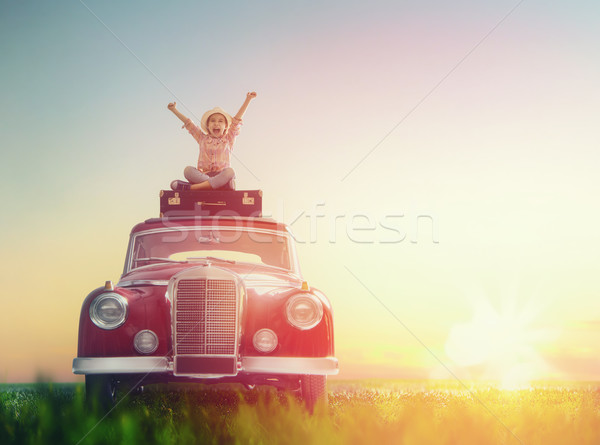 girl sitting on roof of car. Stock photo © choreograph