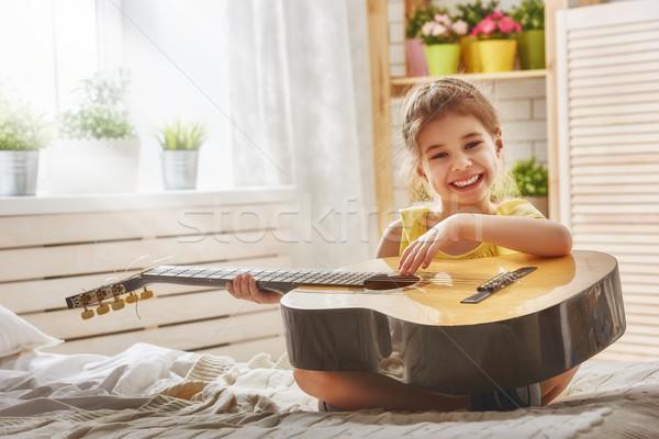 girl playing guitar Stock photo © choreograph