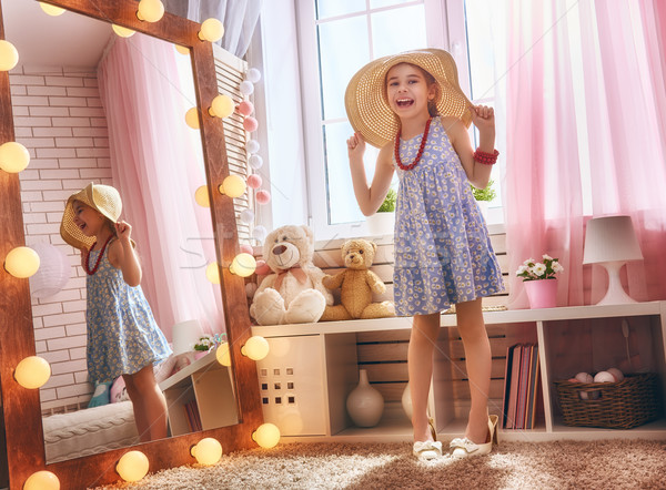 girl dresses up at home Stock photo © choreograph