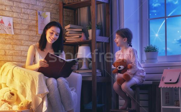 Family reading bedtime Stock photo © choreograph