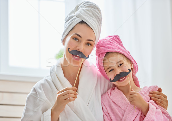 woman and girl with mustache on sticks Stock photo © choreograph