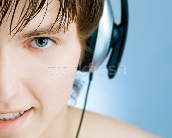 Hombre auriculares azul música tecnología diversión Foto stock © choreograph