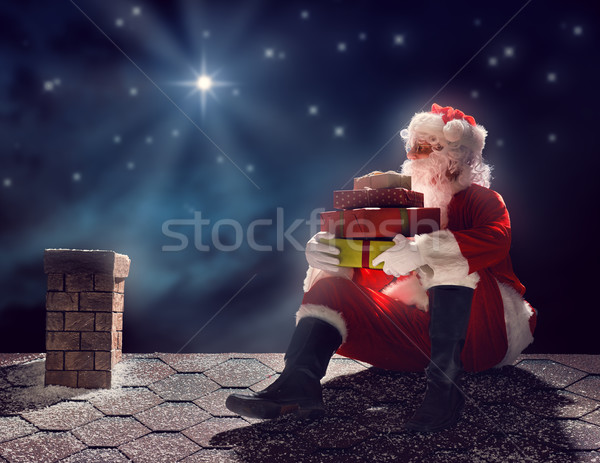 Santa Claus sitting on the roof Stock photo © choreograph