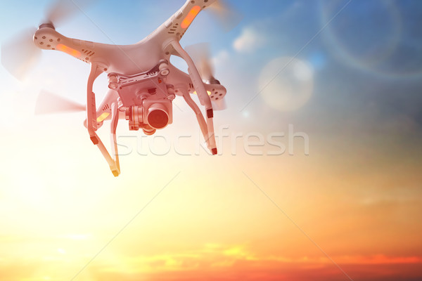 drone in the  sunset sky Stock photo © choreograph