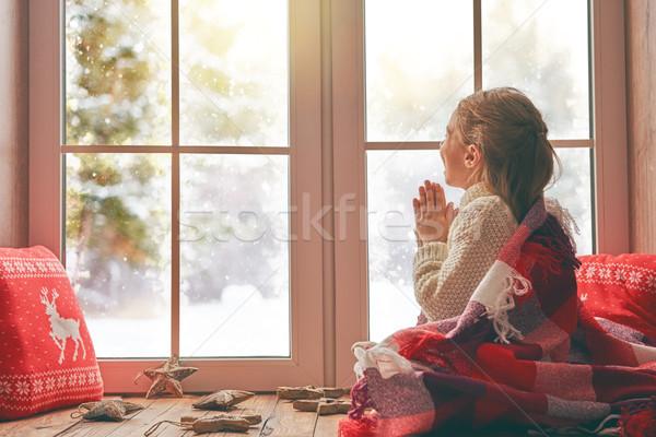 girl by window at Christmas Stock photo © choreograph