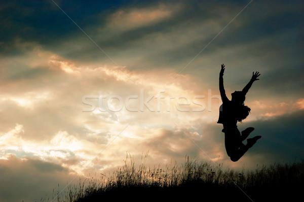 Skoki dziewczyna wygaśnięcia świetle lata zabawy Zdjęcia stock © choreograph