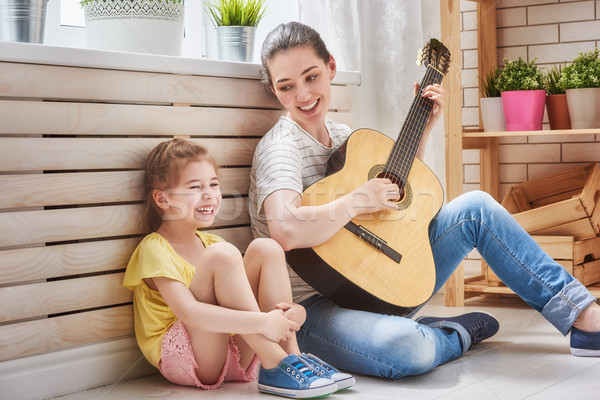 Mother and daughter playing guitar Stock photo © choreograph