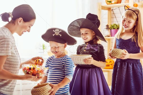 family celebrating Halloween Stock photo © choreograph