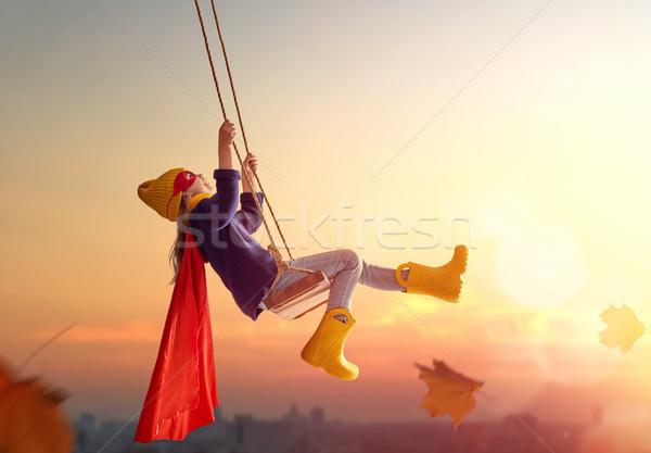 çocuk salıncak mutlu gün batımı düşmek küçük Stok fotoğraf © choreograph