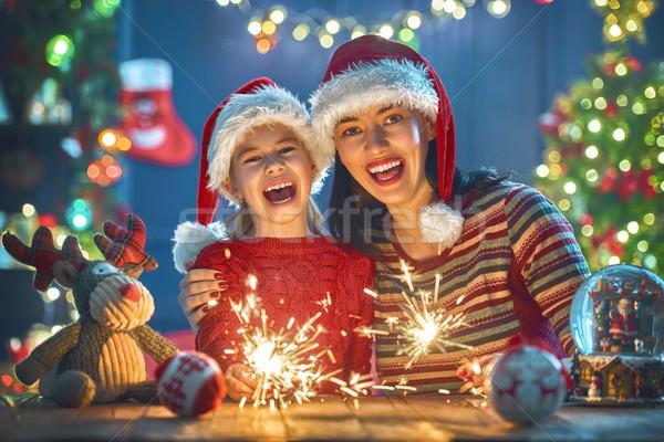Mom and daughter near the Christmas tree Stock photo © choreograph