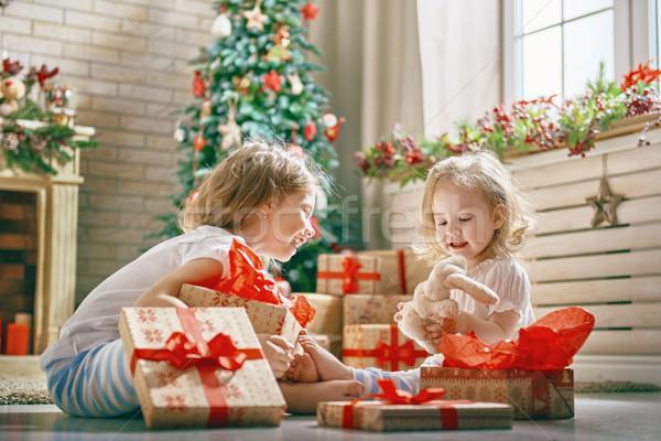 girls opening gifts Stock photo © choreograph