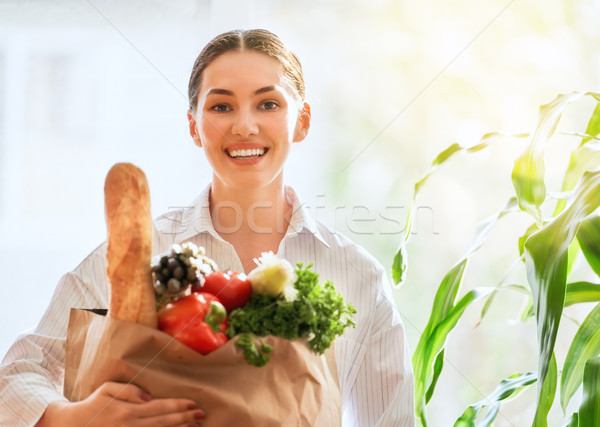 woman holding grocery shopping bag Stock photo © choreograph