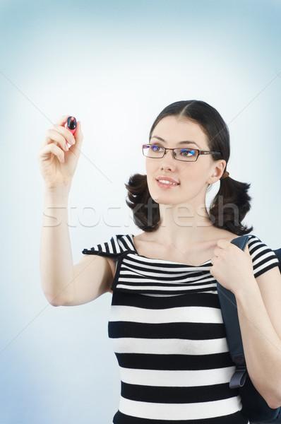 Pisać młodych piękna dziewczyna stałego szkoły kobiet Zdjęcia stock © choreograph