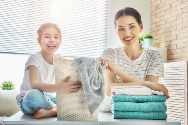 family doing laundry at home Stock photo © choreograph