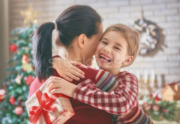 mom daughter exchanging gifts Stock photo © choreograph