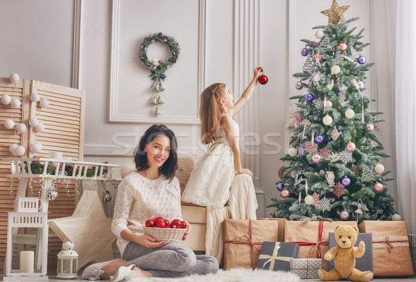 Mom and daughter decorate the Christmas tree. Stock photo © choreograph