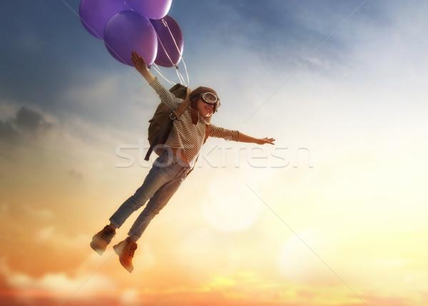 Gyermek repülés léggömbök álmok utazás háttér Stock fotó © choreograph