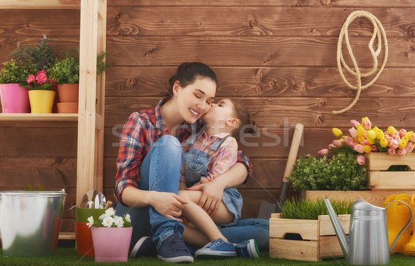 Mother and her daughter engaged in gardening Stock photo © choreograph