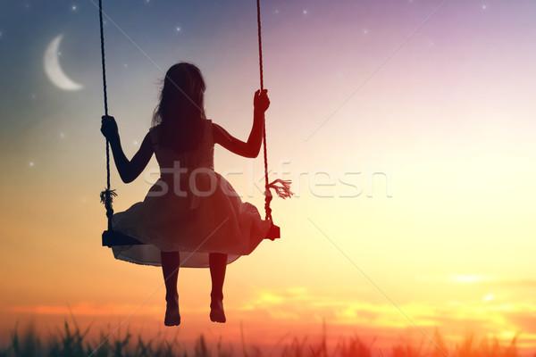 çocuk kız salıncak mutlu gün batımı yaz Stok fotoğraf © choreograph