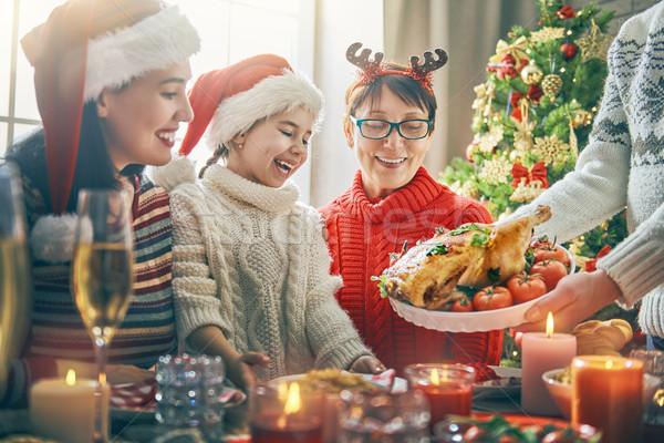 Family celebrates Christmas. Stock photo © choreograph