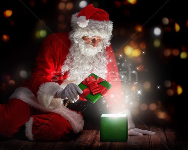 Santa Claus with christmas gifts Stock photo © choreograph