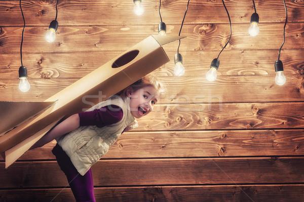 girl plays astronaut Stock photo © choreograph