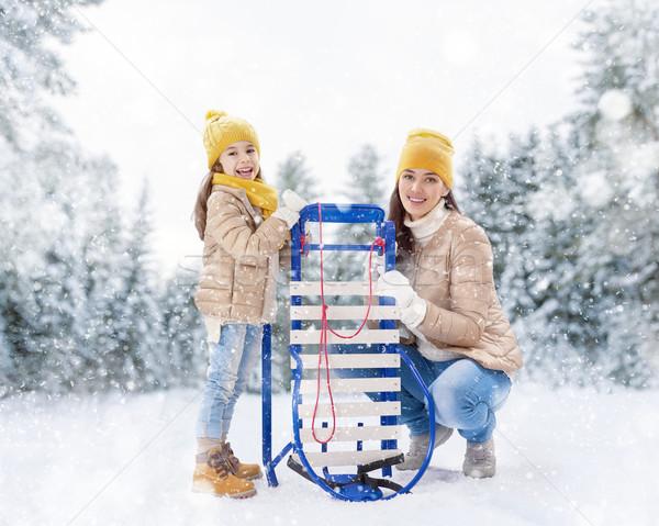 girl and mother sledding Stock photo © choreograph