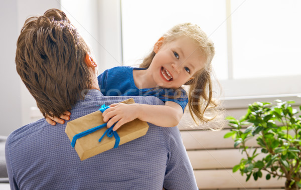 daughter congratulating dad Stock photo © choreograph