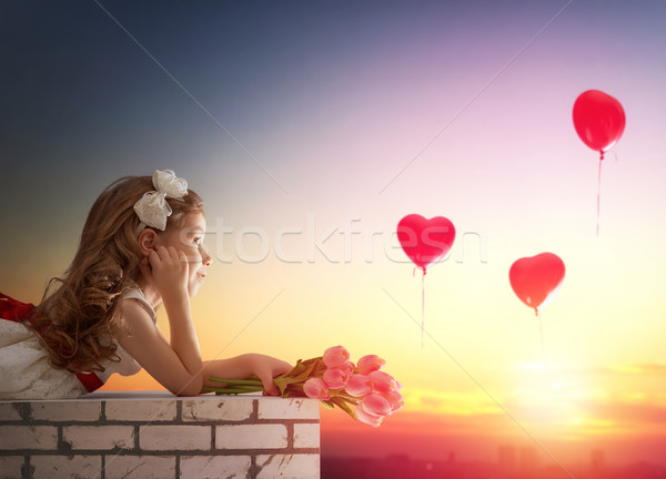 Stock photo: girl looking at red balloons