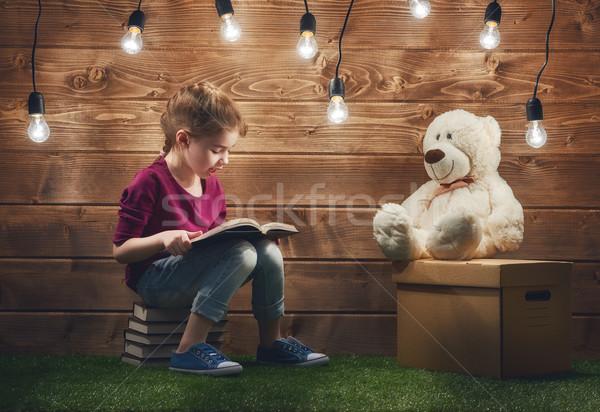 Stock photo: girl reading a book
