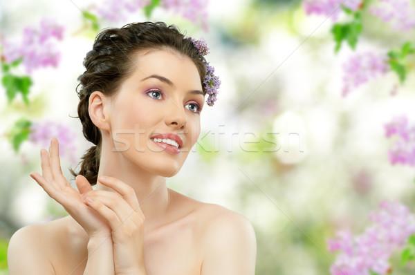 Lány orgona gyönyörű lány virág mosoly arc Stock fotó © choreograph