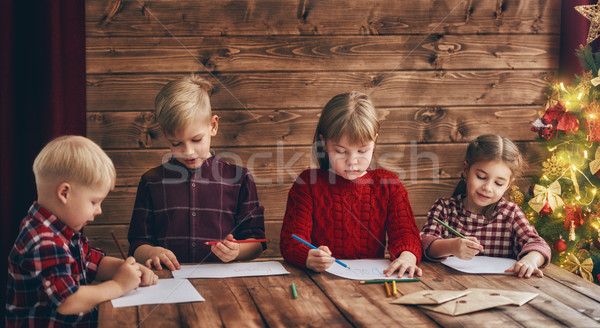 kids writing letters to Santa Claus Stock photo © choreograph