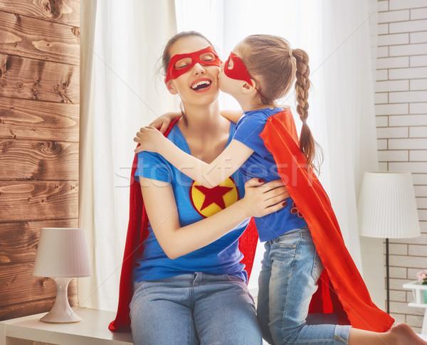 Girl and mom in Superhero costumes Stock photo © choreograph