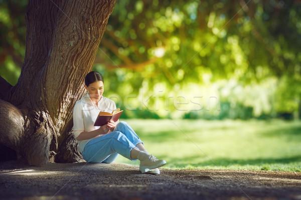 woman reading a book Stock photo © choreograph