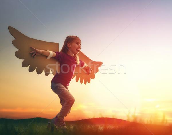 Kid ali uccello bambina esterna bambino Foto d'archivio © choreograph