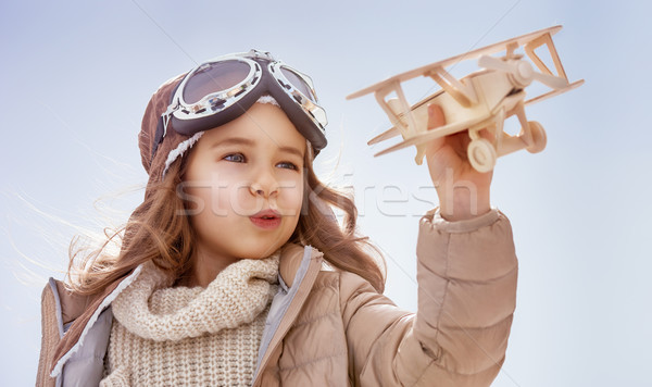 girl playing with toy airplane Stock photo © choreograph