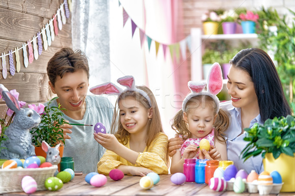 family are painting eggs Stock photo © choreograph