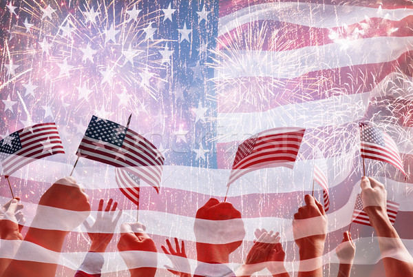 Hands of people holding the Flags of USA. Stock photo © choreograph