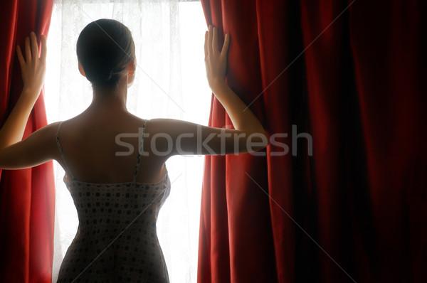 Piros függönyök csinos nő nyitás ablak szépség Stock fotó © choreograph