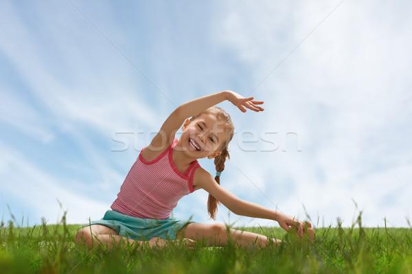 child practicing yoga Stock photo © choreograph