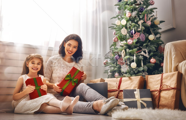 Mother and daughter exchanging gifts Stock photo © choreograph
