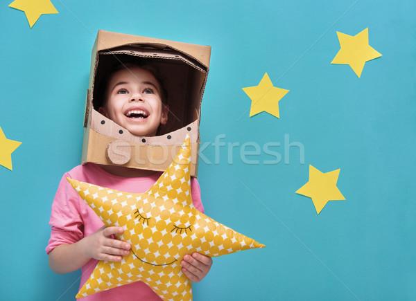 girl in an astronaut costume Stock photo © choreograph