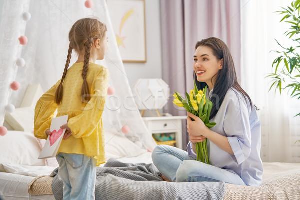 Stock fotó: Lánygyermek · anya · boldog · nőnap · gyermek · virágok