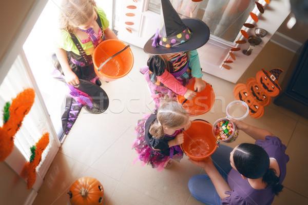 Stock photo: family celebrating Halloween