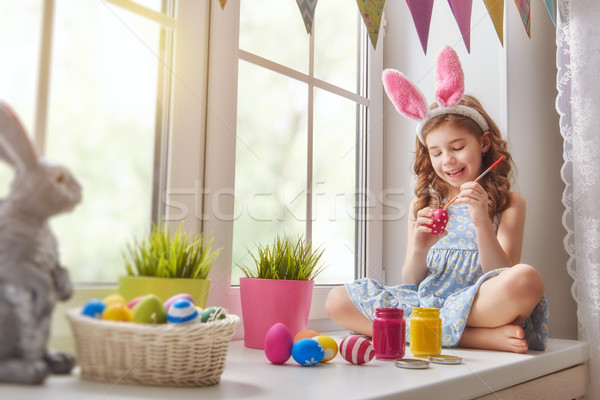 Stock photo: child painting eggs