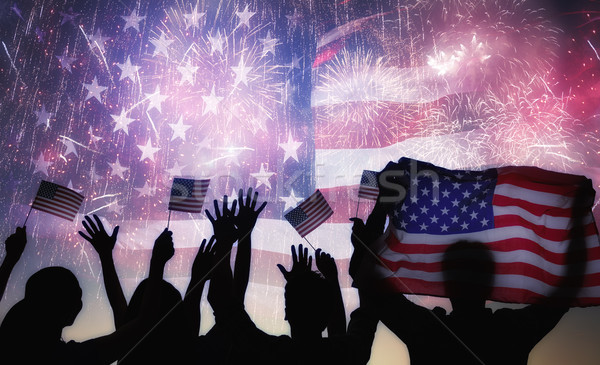 Silhouettes of people holding the Flag of the USA. Stock photo © choreograph