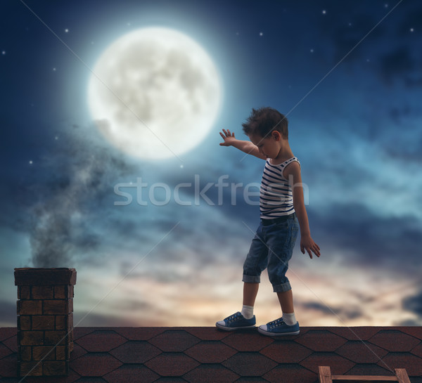 Stock photo: boy walks on the roof