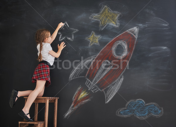 child drawing stars and rocket Stock photo © choreograph
